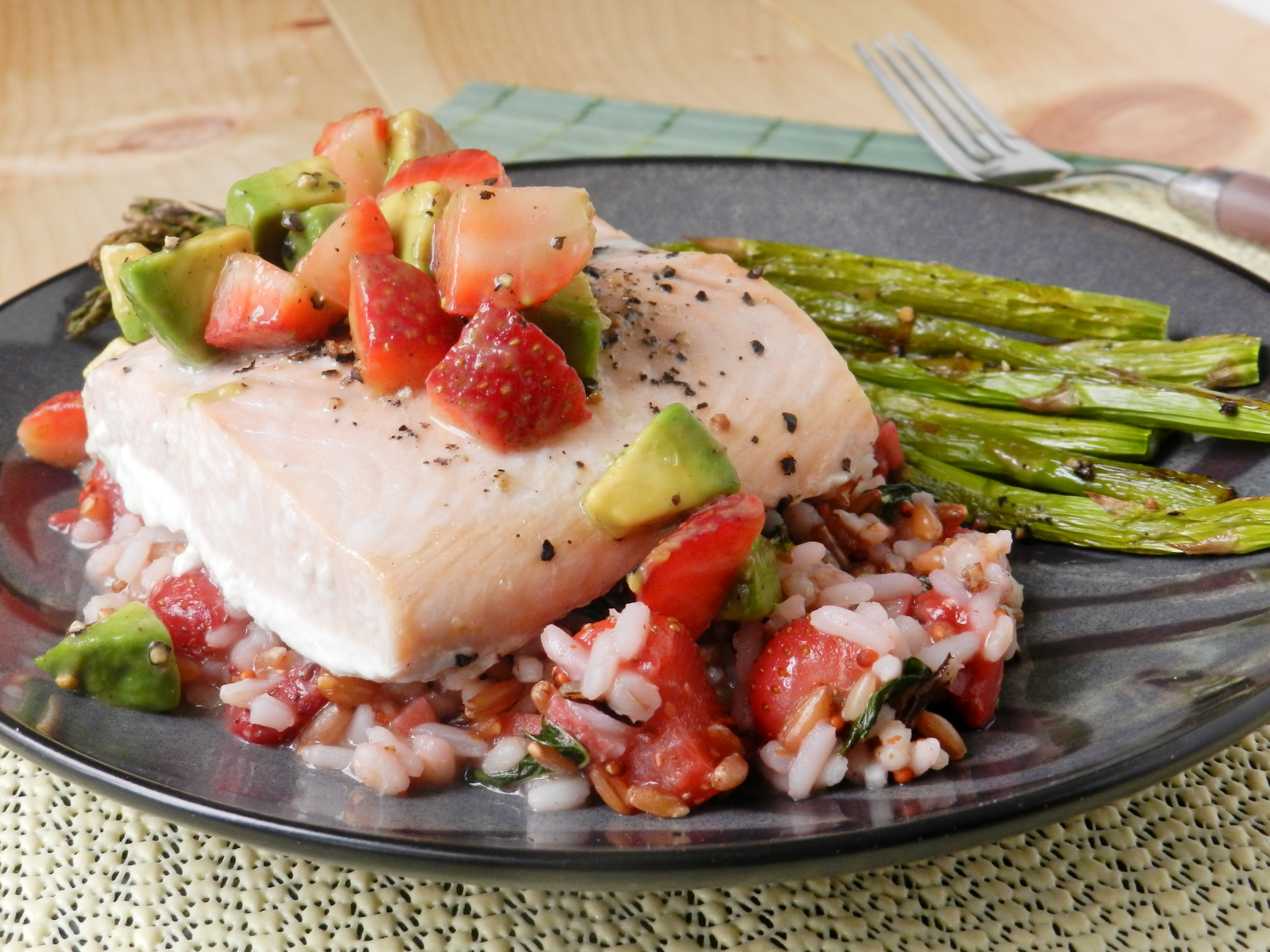 salmon with a stawberry basil rice pilaf and strawberry avocado salsa